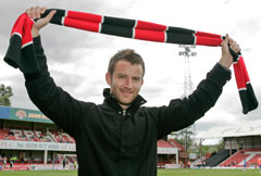 Supporter branding a Brentford FC scarff