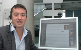 Russell Stannard in front of a computer monitor