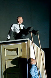 Exhibition example depicting a man on a box above another man looking up