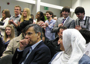 Students stand and applaud their families at Westminster Business School's Student Achievement Awards Ceremony