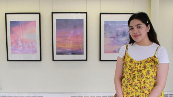 Angel Bacani with her work As The Sun Sleeps