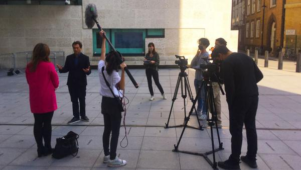 Film students outside BBC offices on set filming videos for 50:50 project
