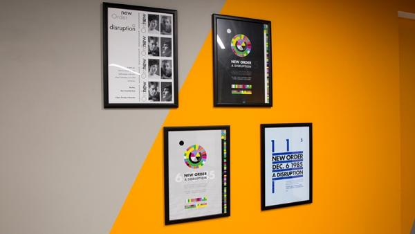 Four hanging posters of the groups New Orders of Disruption