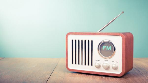 Retro old radio on mint green background.