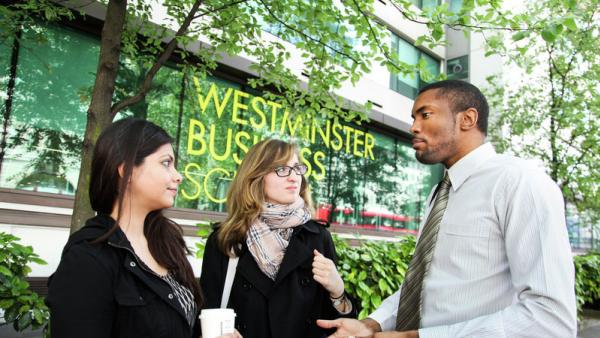 Three students stood outside Westminster Business School Marylebone Campus