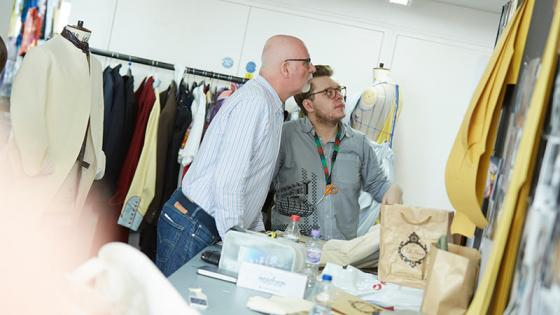 Tutor giving feedback in the fashion studios