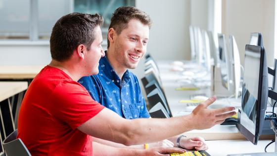 student teacher teaching computers