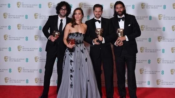 Babak Anvari (left), 2005 graduate, winning the 2017 BAFTA for Best Debut Feature for writing and directing 'Under the Shadow'