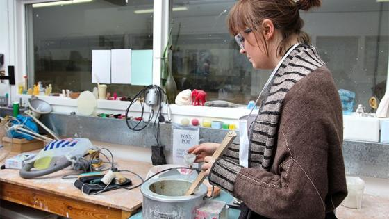 Student using equipment in one of Westminster's art and design facilities