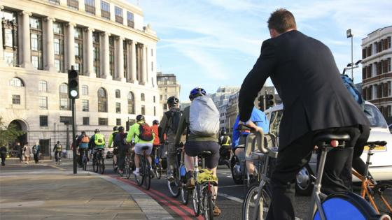 Cyclists on the road in London on a sunny morning