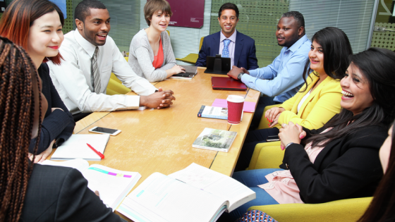 postgraduate students sitting round a table