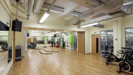 A large room with gym facilities