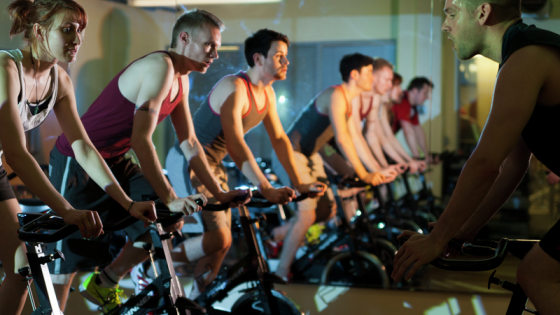 A class of people exercising on bicycles in a studio
