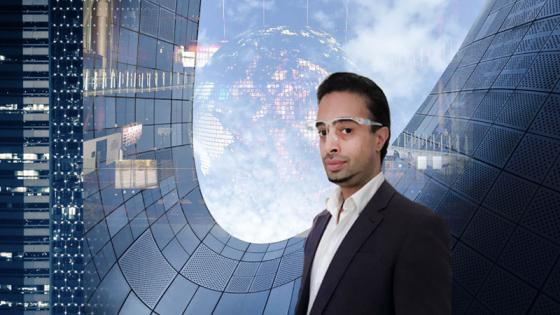 Savraj Matharu wearing goggles in front of a tech background