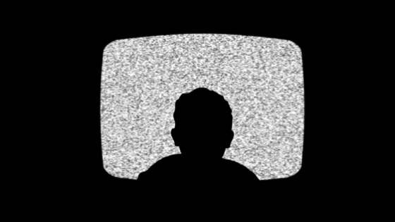 Silhouette of a child in a television screen