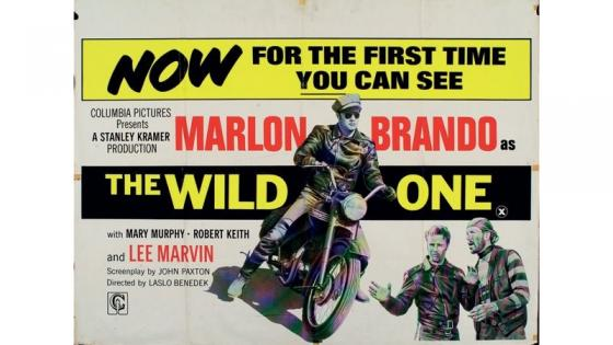 This is a poster of The Wild One and Marco Brando riding a motorbike
