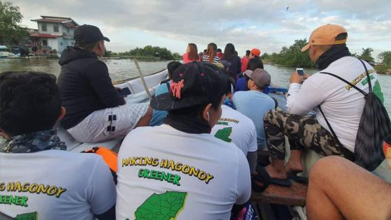 Volunteers being transported via boat to the mangrove site
