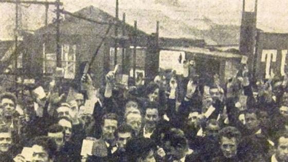 Barbican workers show union cards