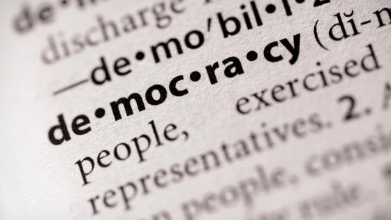 Image of teh word democracy in a dictionary