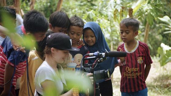 3rd year students with local children in Indonesia during filming of documentary 'Tono'