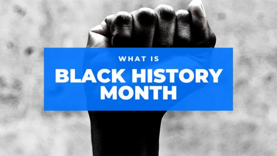 Black and white image of fist with title 'what is Black History Month' layered on top