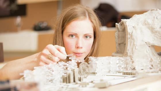 A girl building a model
