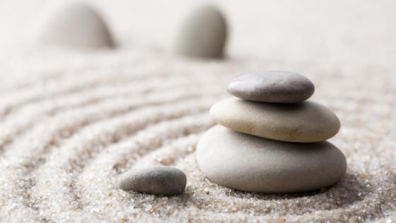 A pile of zen stones on sand