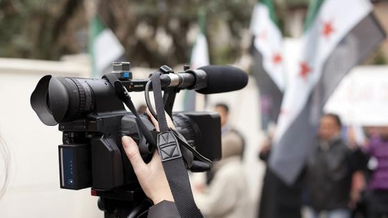 Reporter recording Arab manifesto on camera