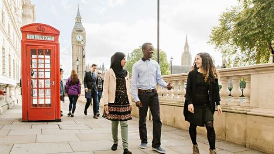 Students walking by the Thames