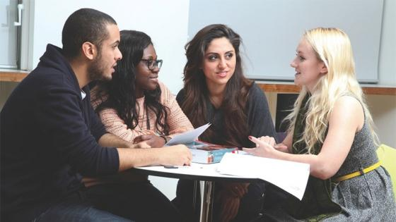 Students talking around a table