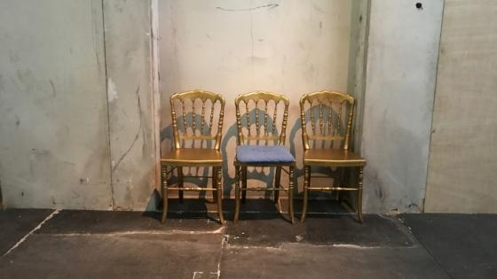 Image of three gold chairs