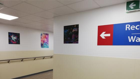 three-paintings-in-corridor