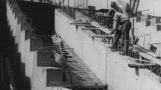 Workers on a staircase construction site